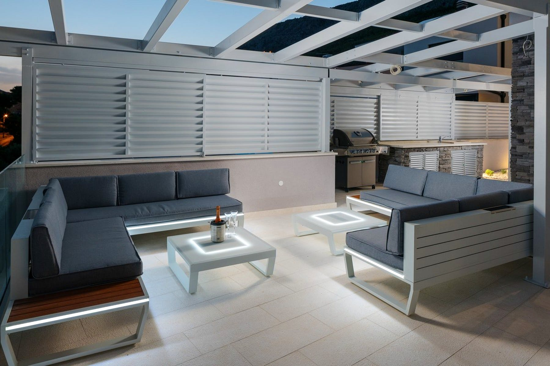 Outdoor lounge with a barbeque