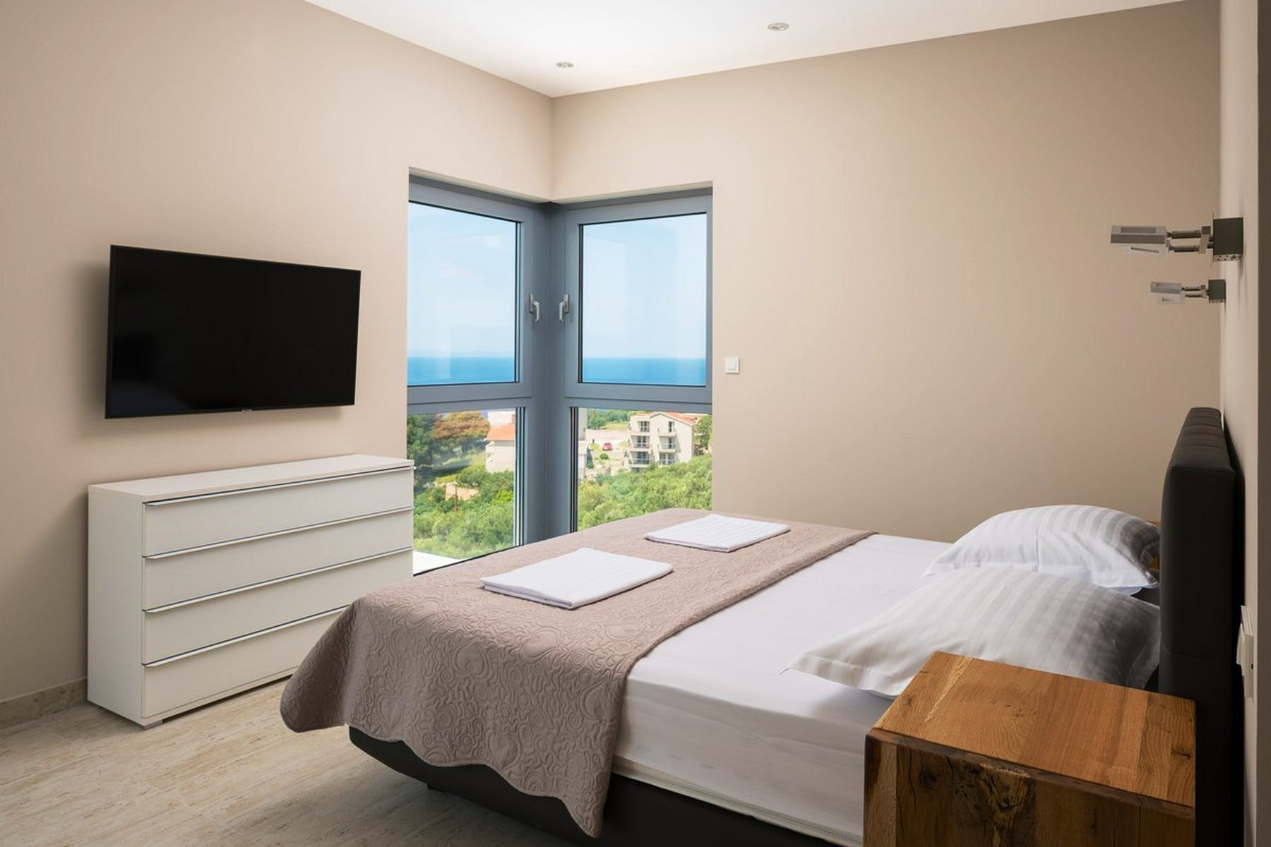 Modernly equipped bedroom with a view