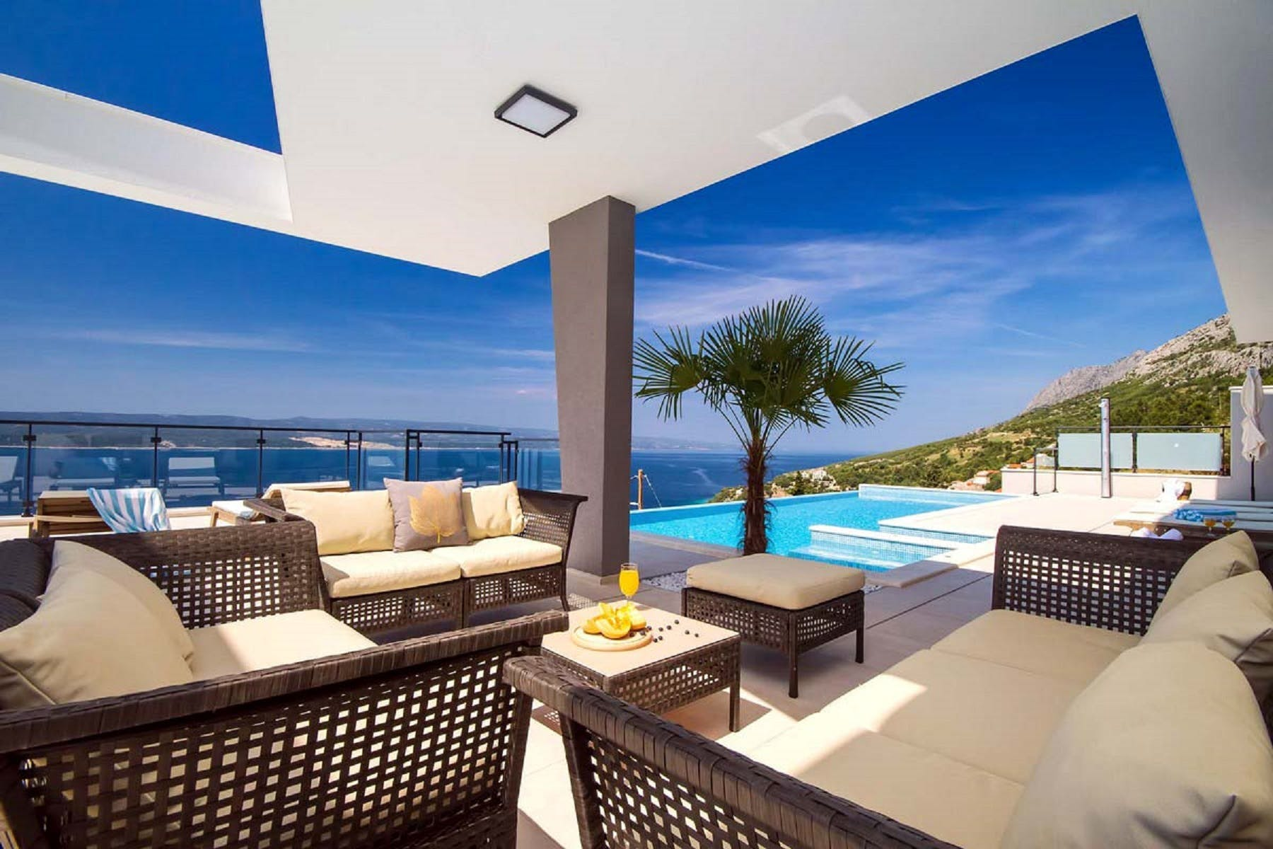 Cozy sunbathing and lounge area by the pool