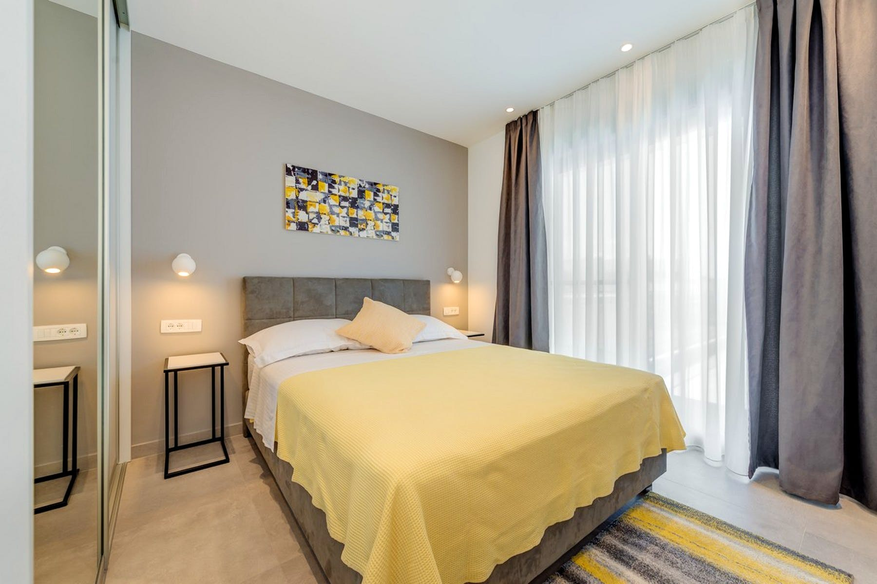 Double bedroom enhanced with yellow details
