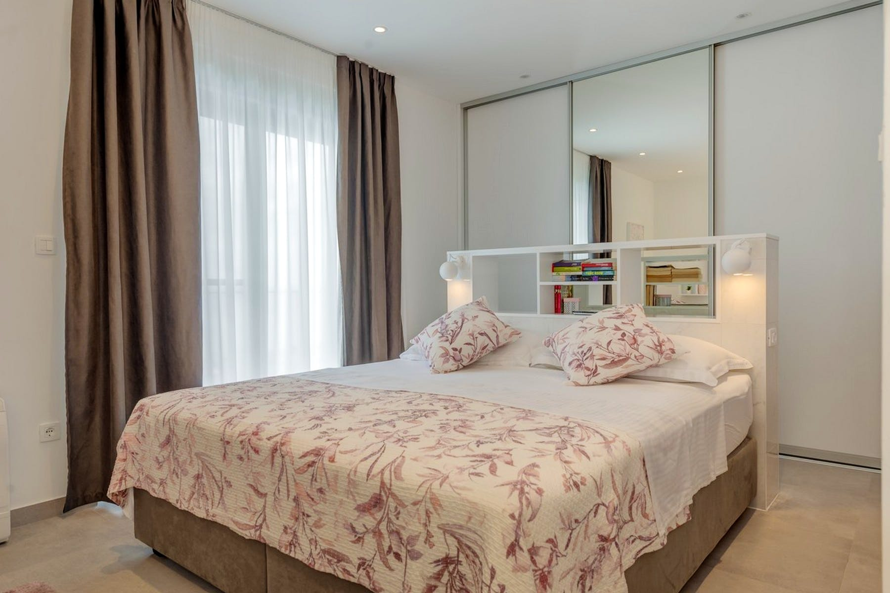 Double bedroom with large mirrors