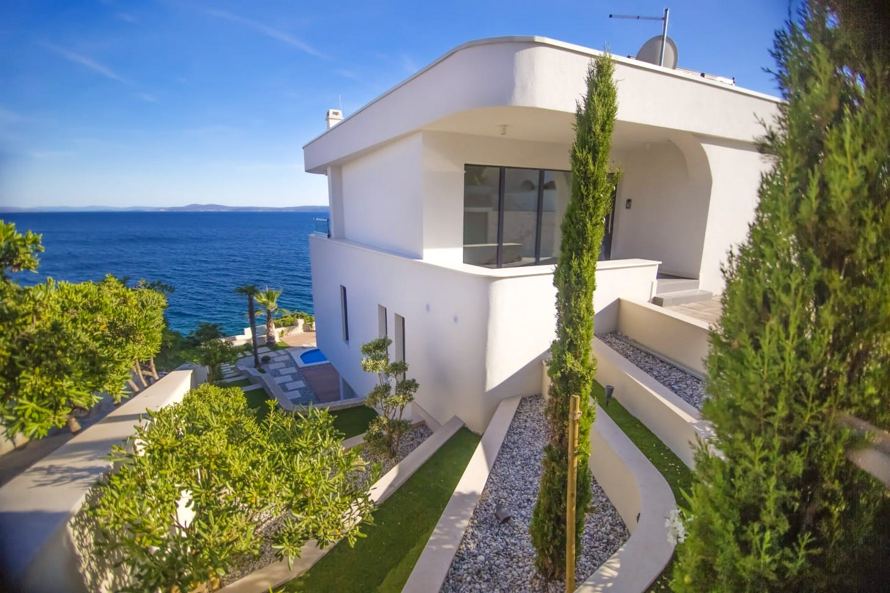 Modern villa for sale first row to the sea