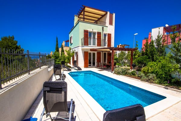 A modern property boasting a large pool