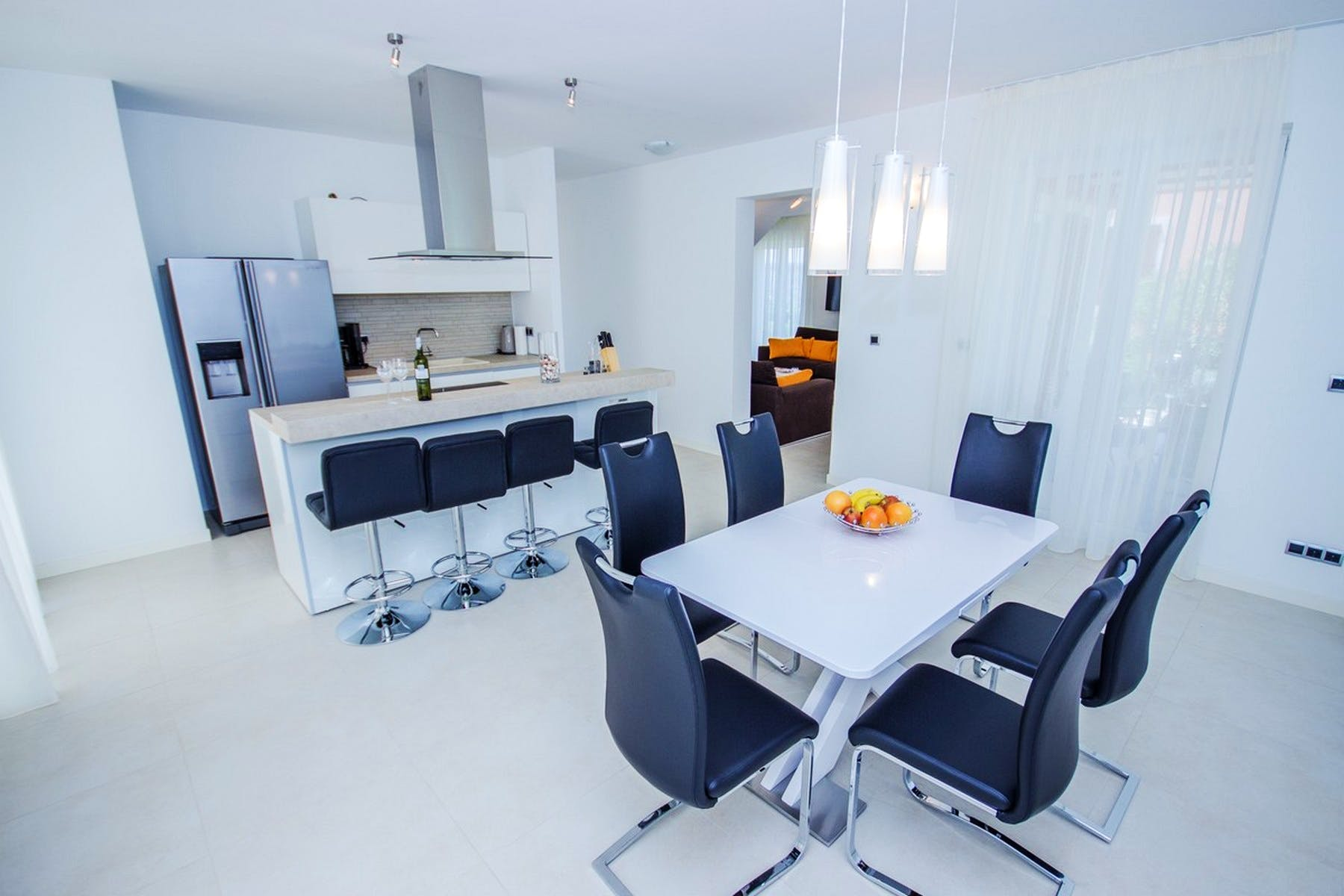 Black and white decor of the cooking and dining area