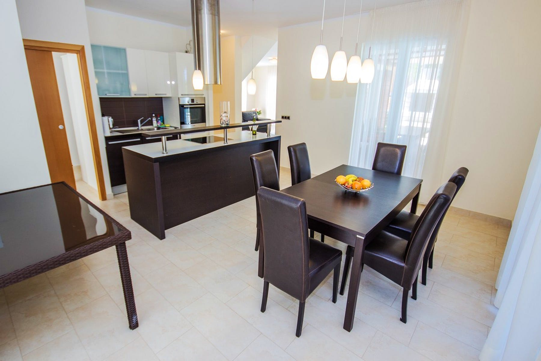 Another angle on the dining area and kitchen