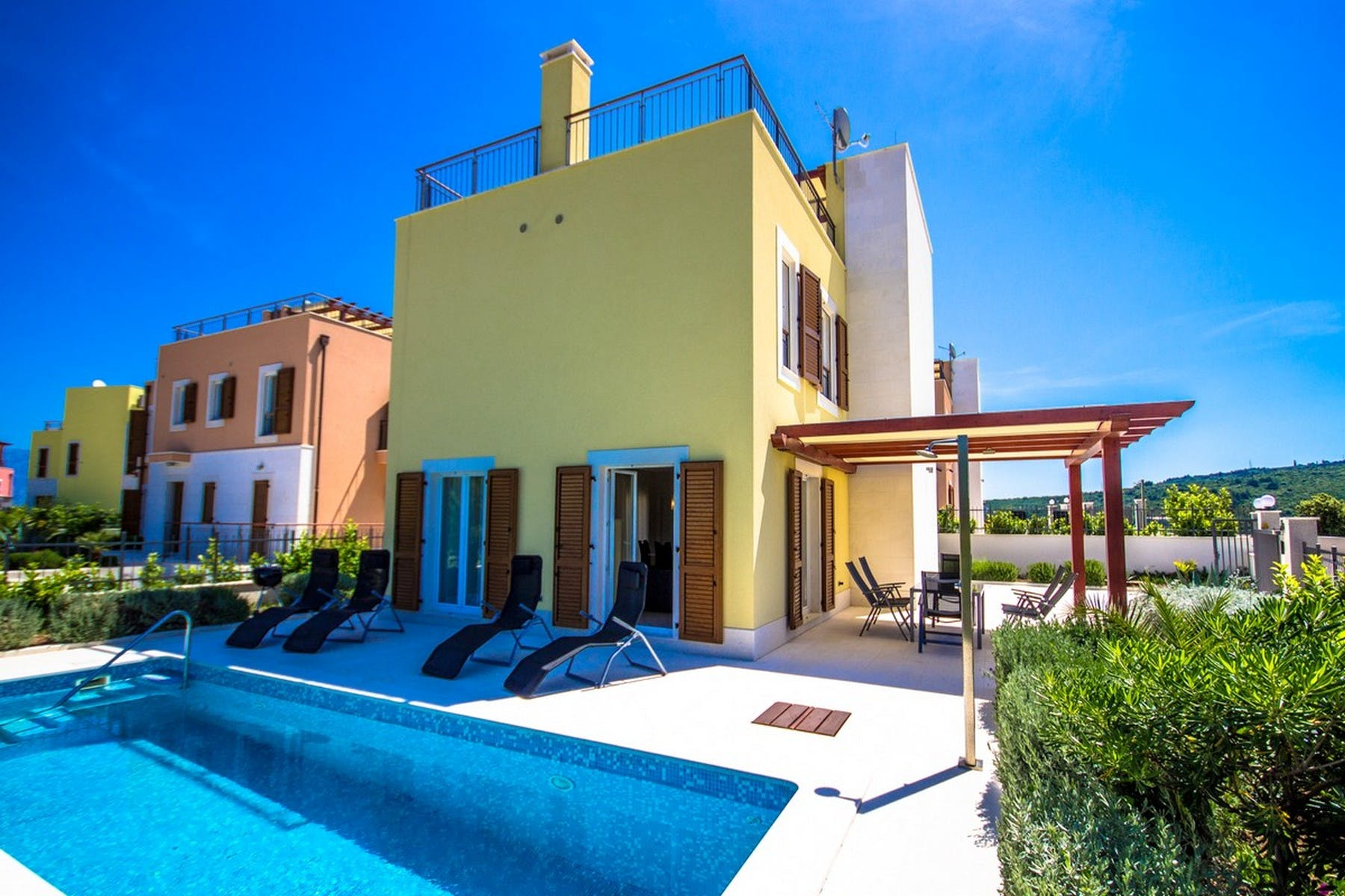 Full view of the villa with a pool