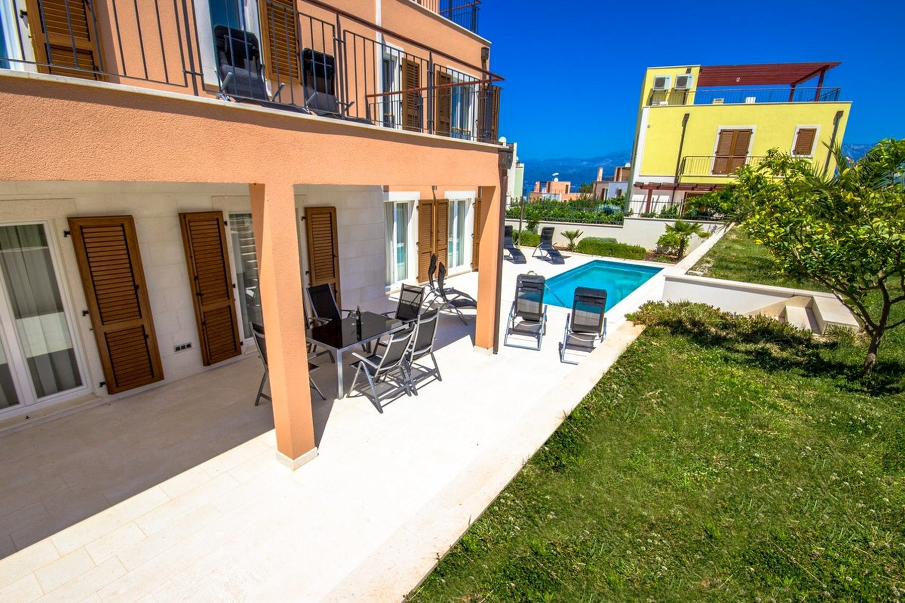 Spacious terrace with lounge area and a swimming pool