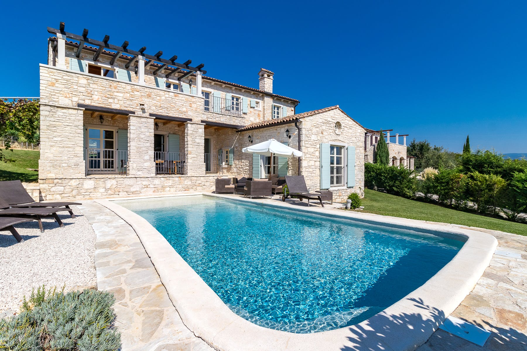 Stone property with a pool