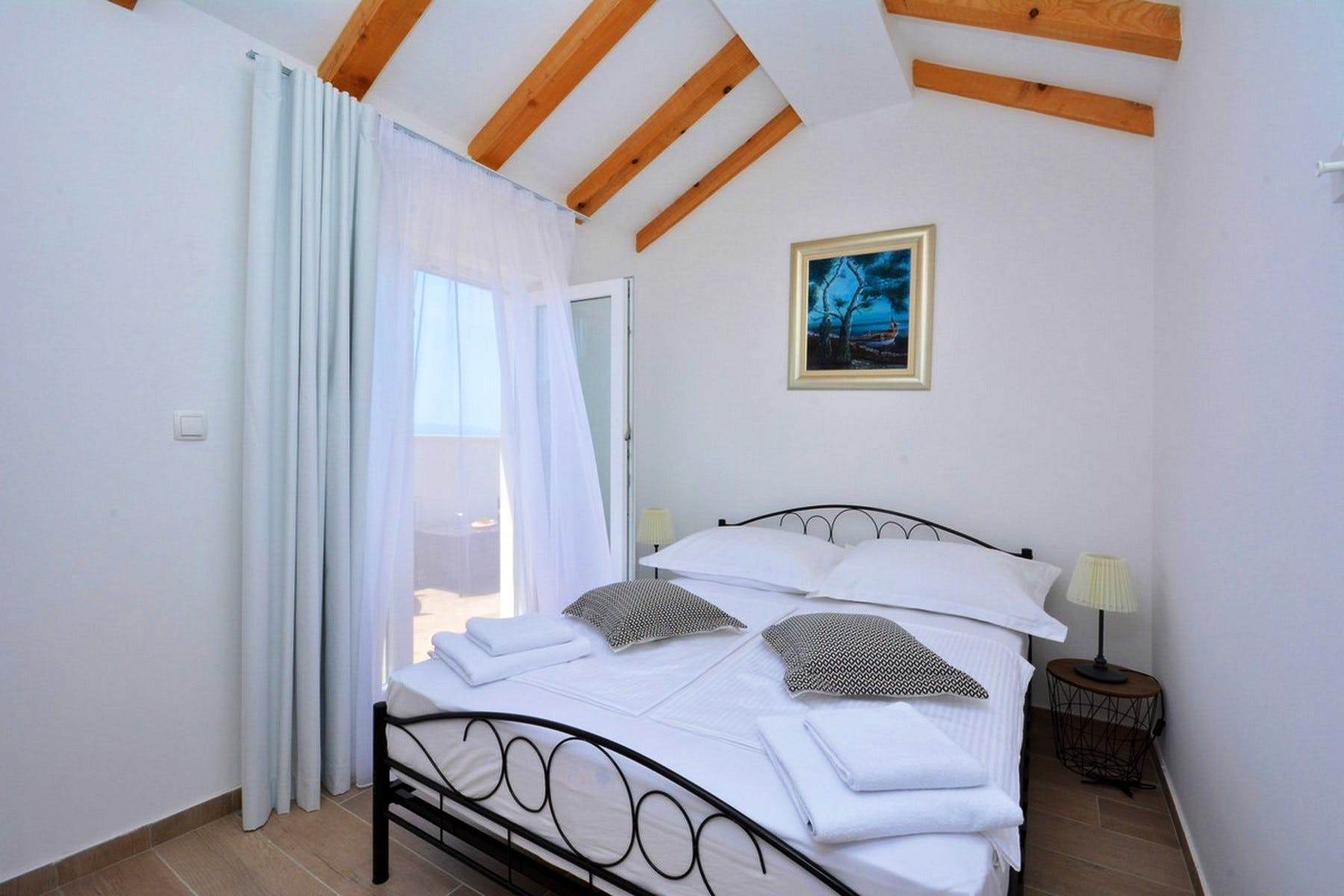Double bedroom decorated with beams