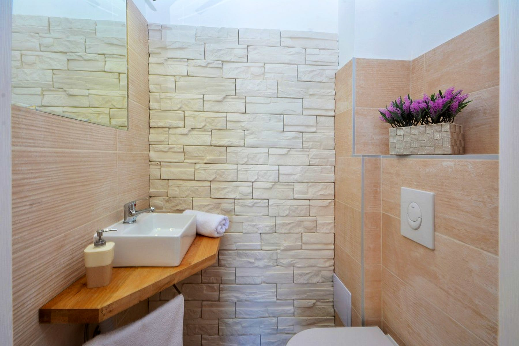 Bathroom with stone details