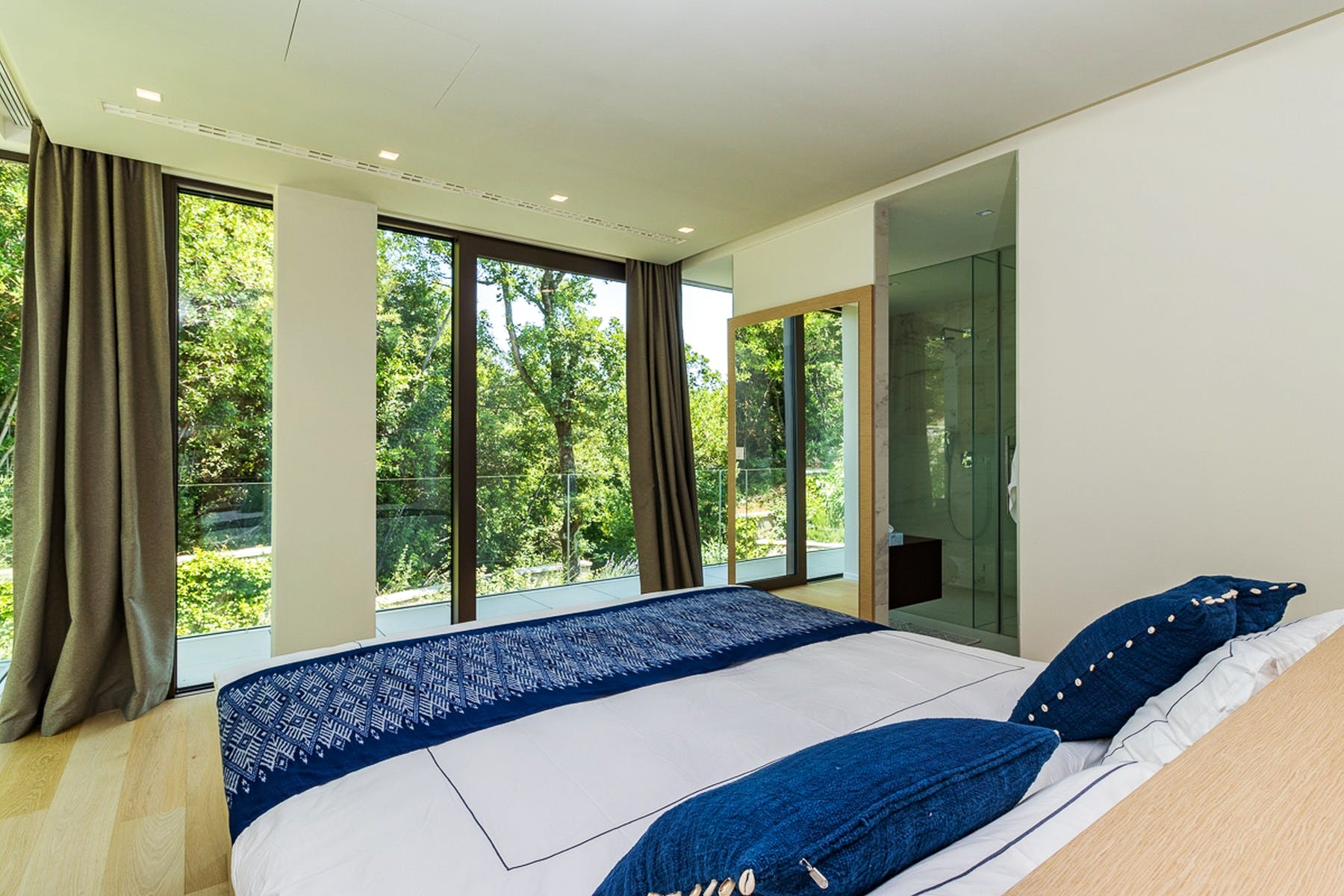 Bedroom with a forest view