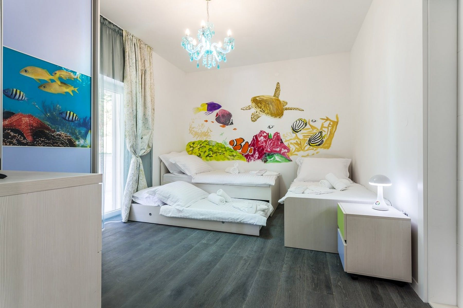 A bedroom for three with aquamarine motives