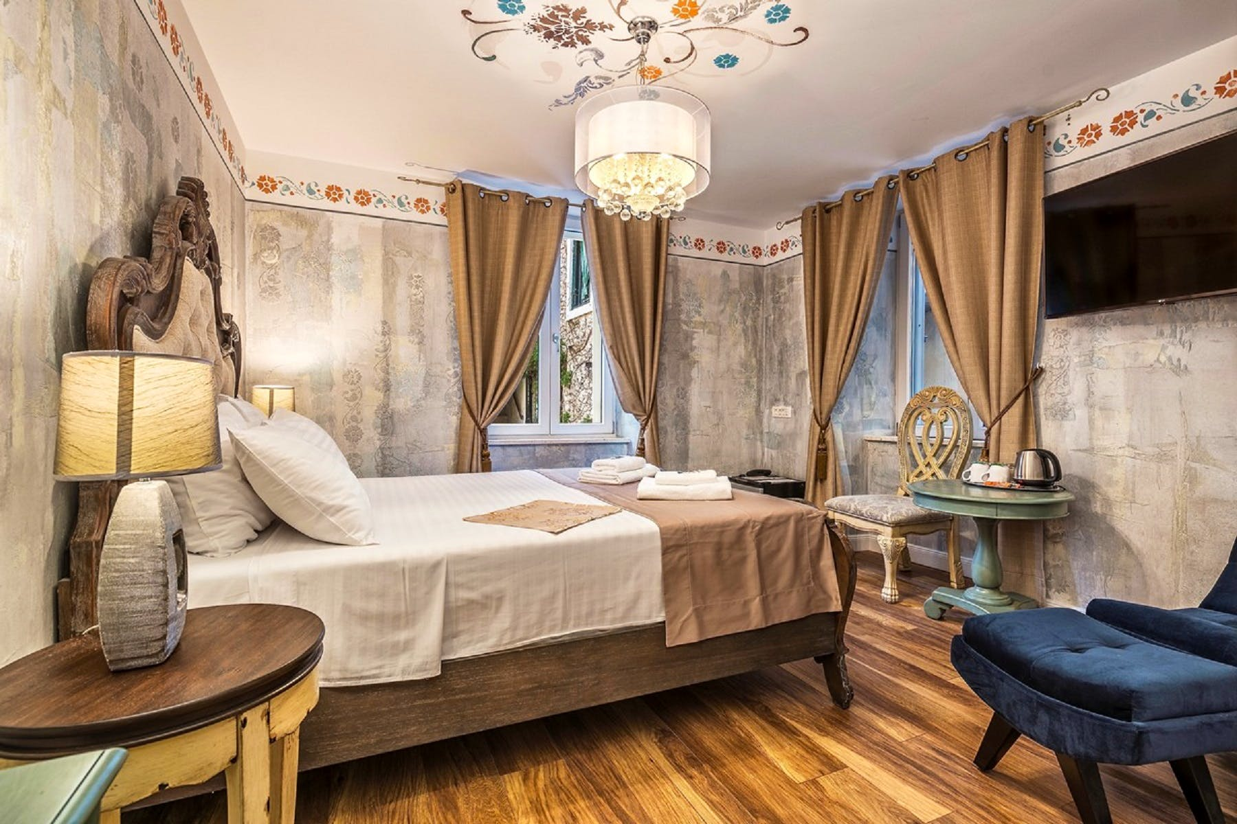 Marvelous chandeliers can be found in bedrooms as well