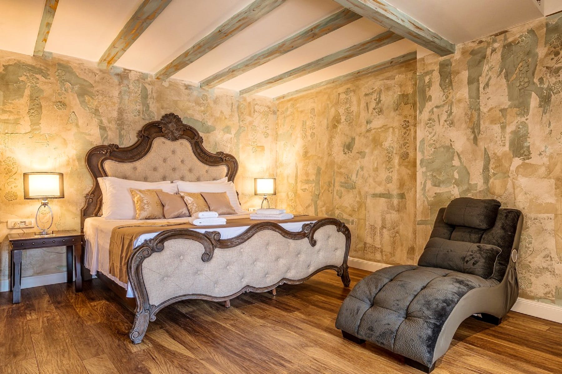 Massive double beds make the centerpiece of every room