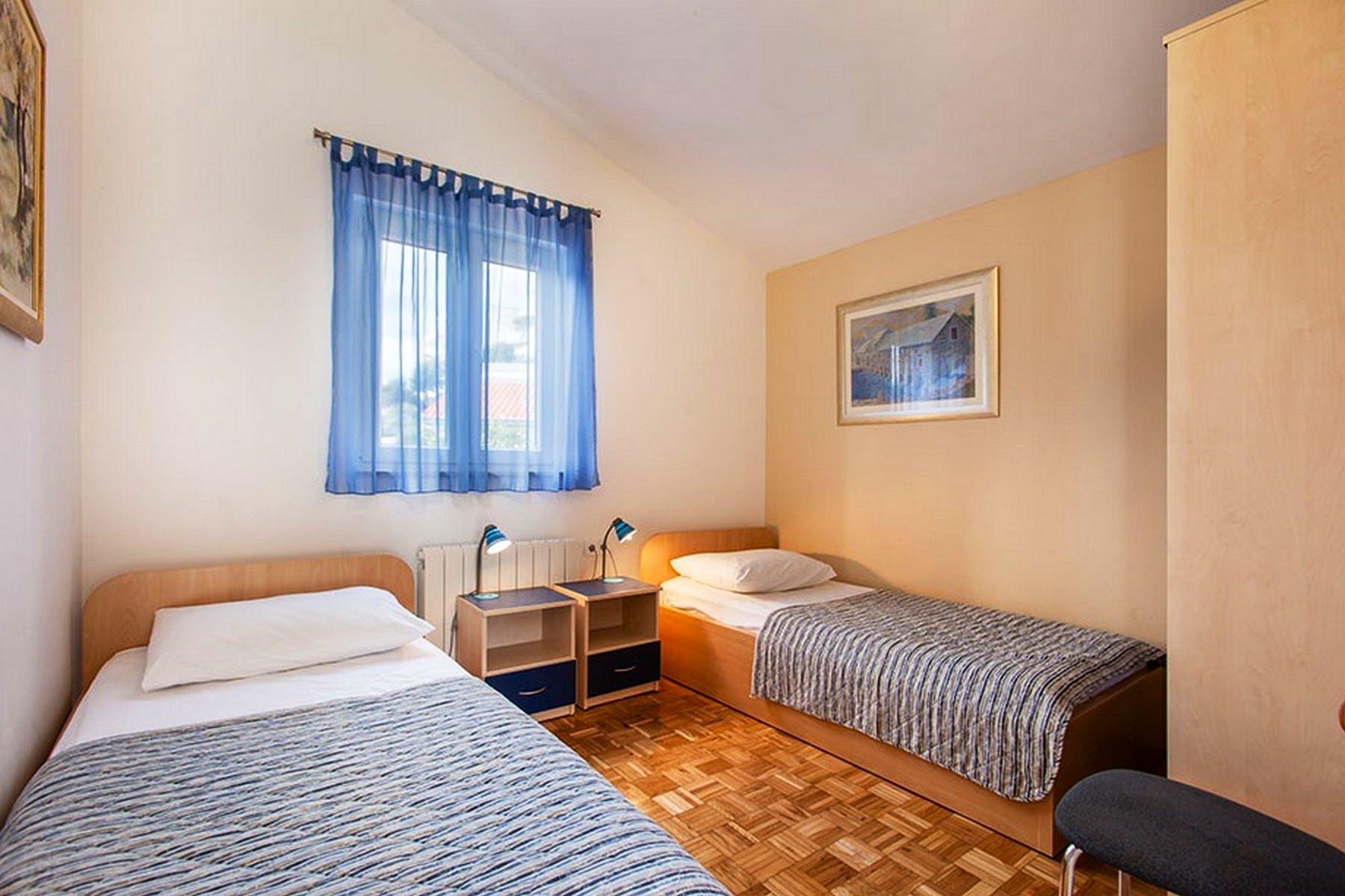 Twin bedroom in neutrals