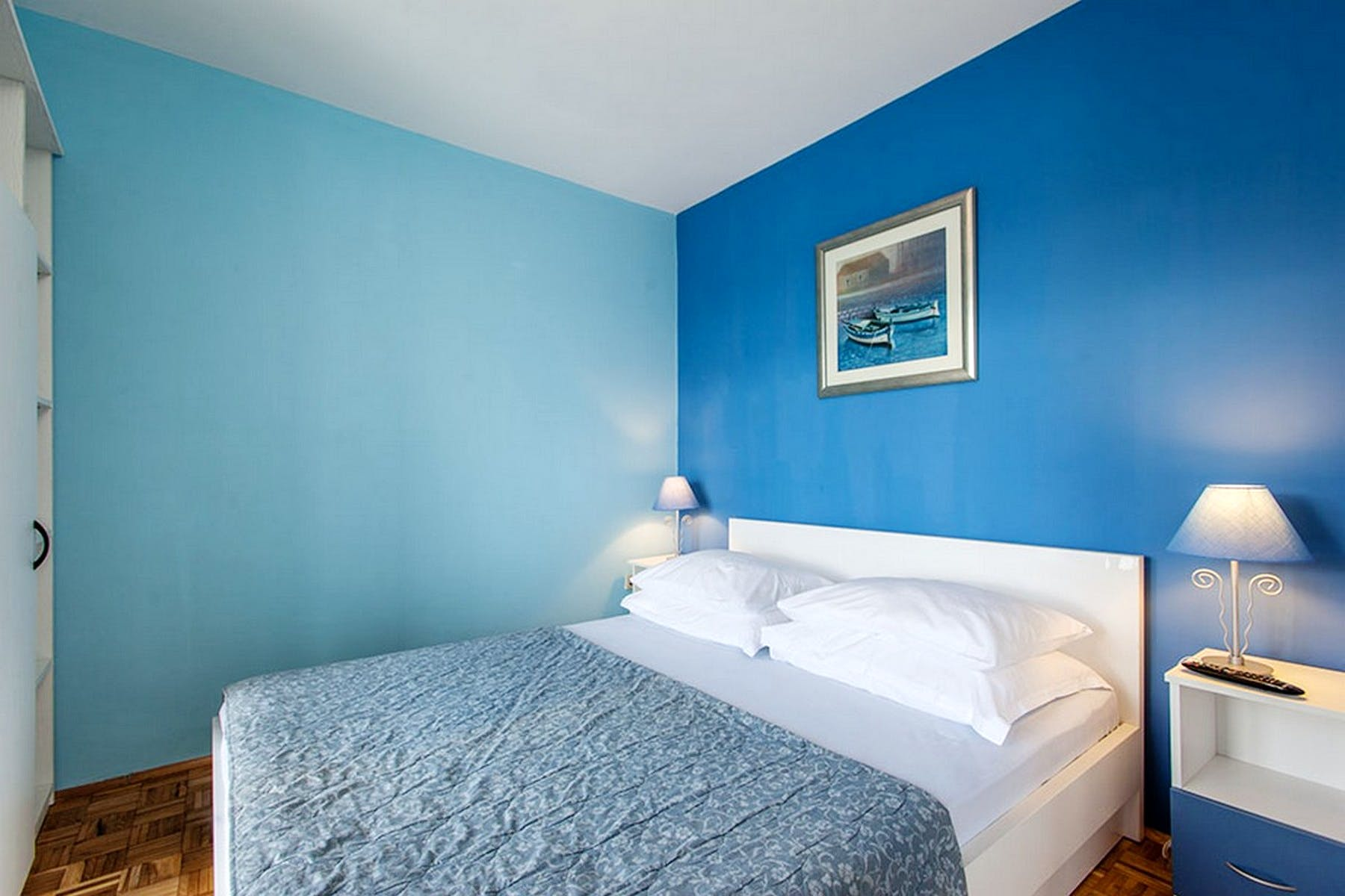 Different shades of blue in the double bedroom