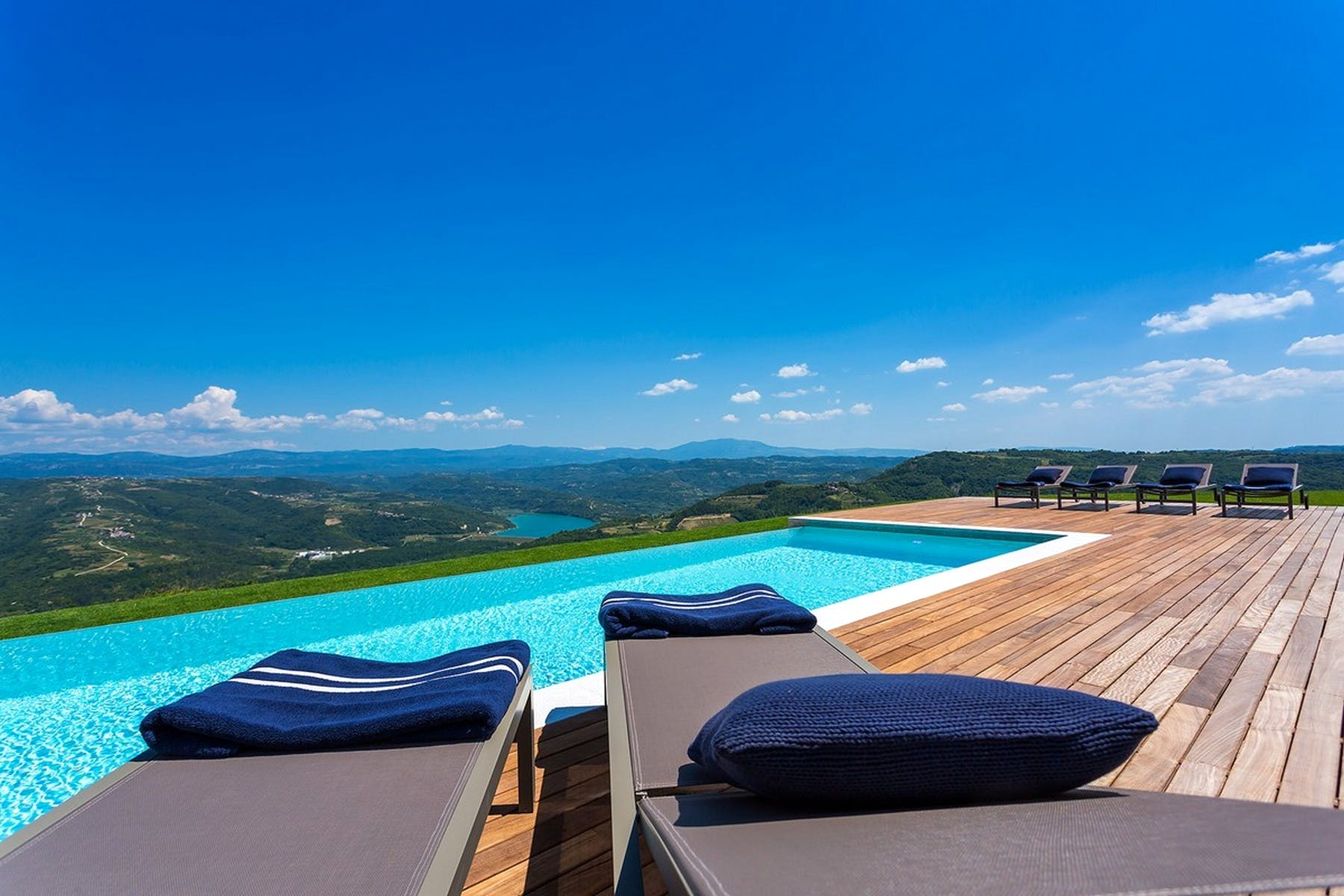 View of the pool from the sunbathing area