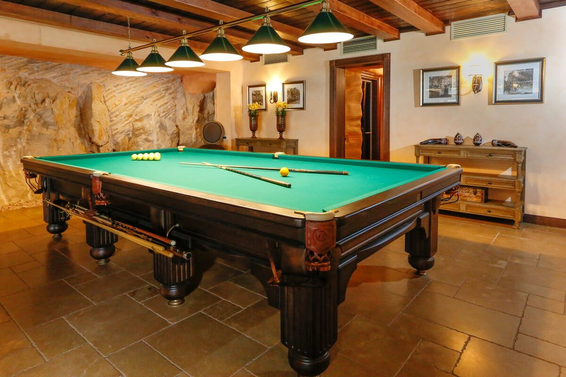 Entertainment room with large billiards table