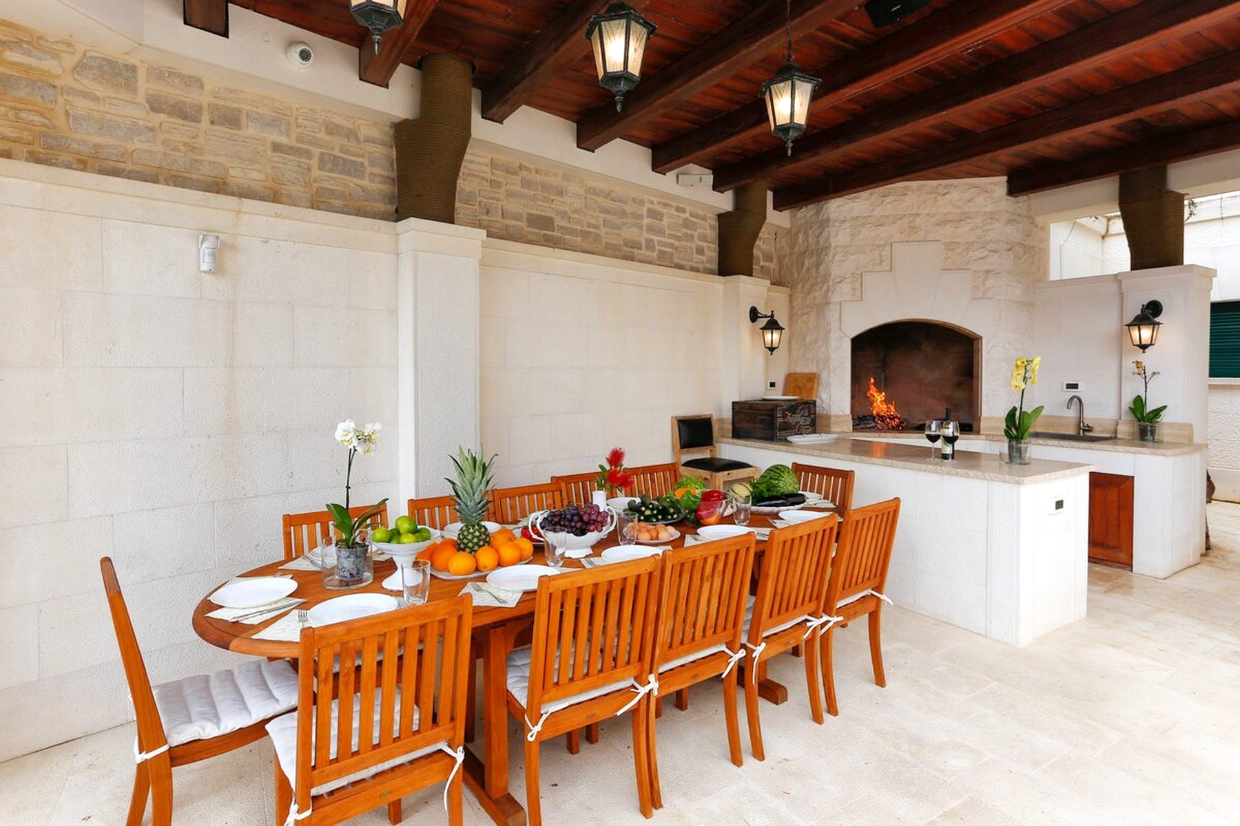 Large outdoor table near the fireplace