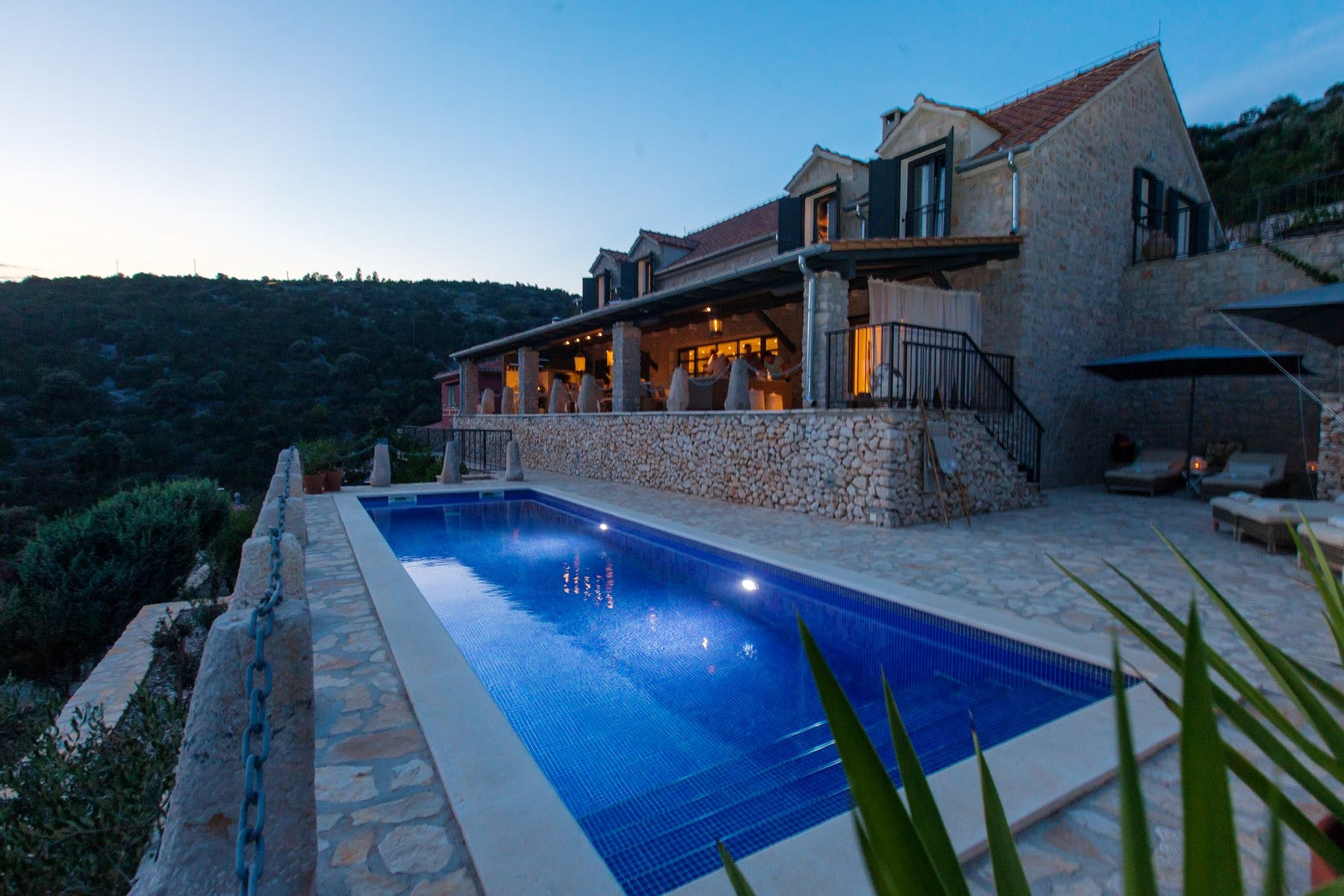 Night view of the villa and pool