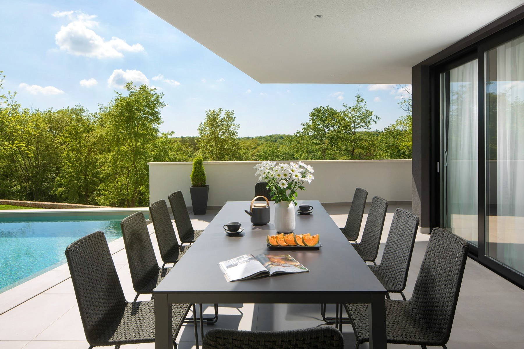 Spacious dining table in front of the villa