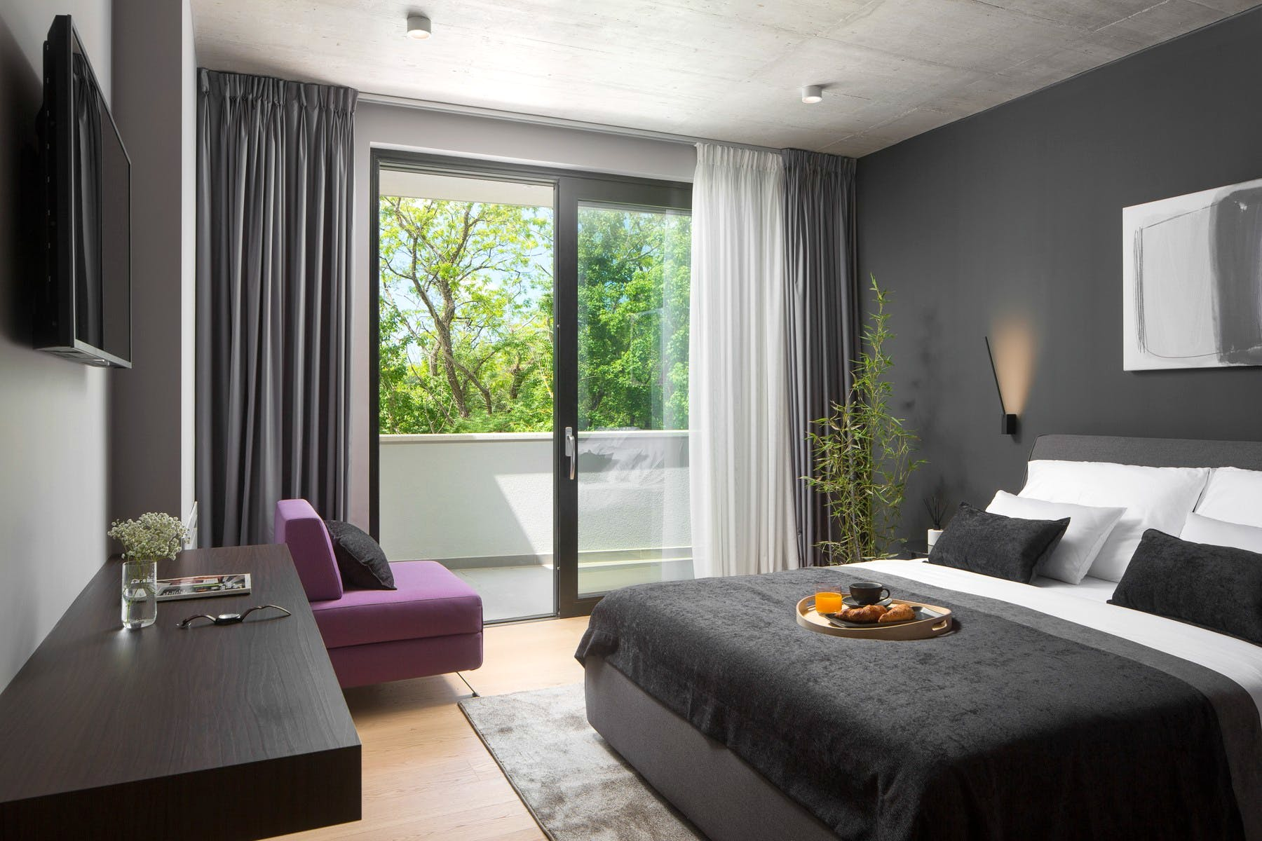 Spacious bedroom with balcony