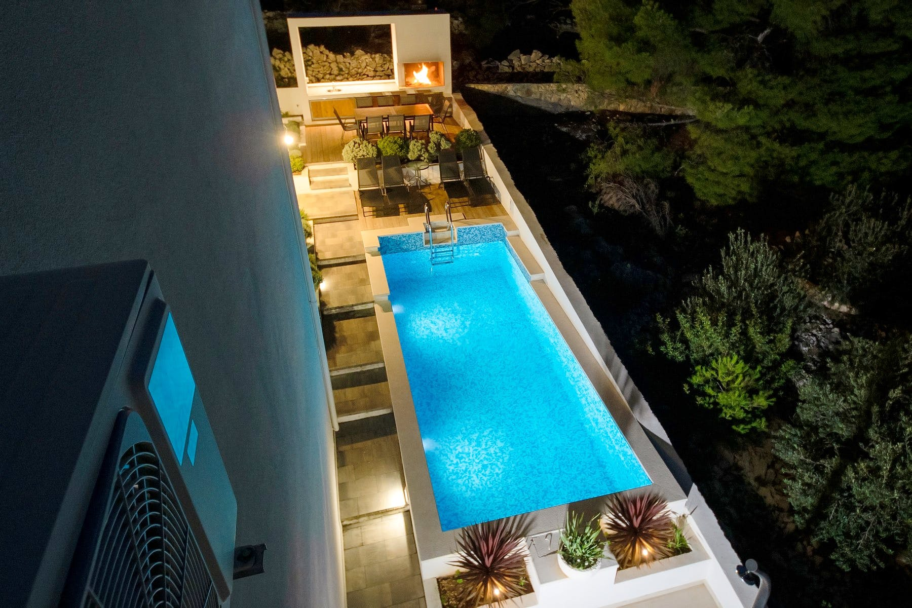Night view of the pool, sundeck and barbecue
