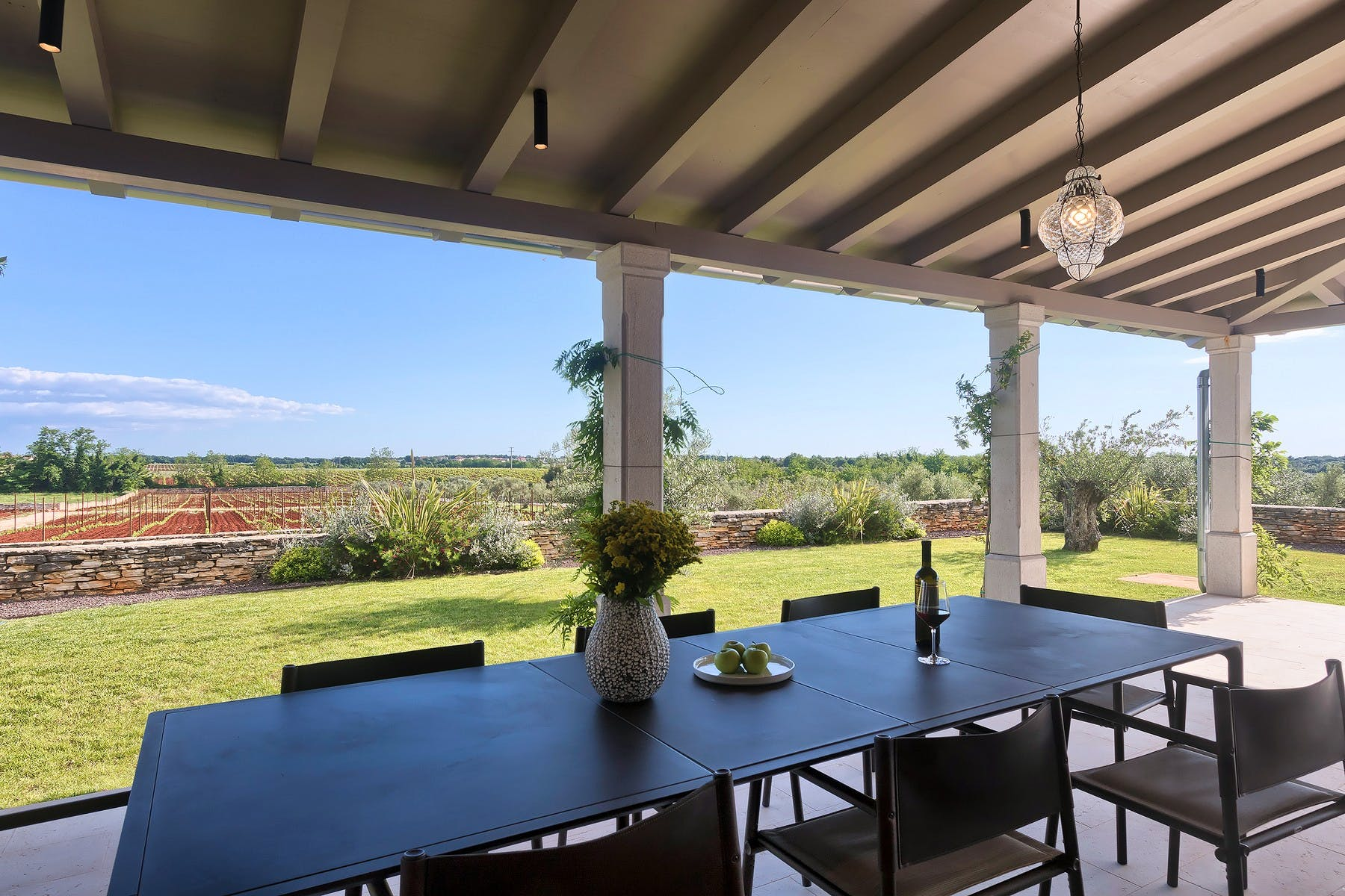 Outdoor dining table with scenic nature view