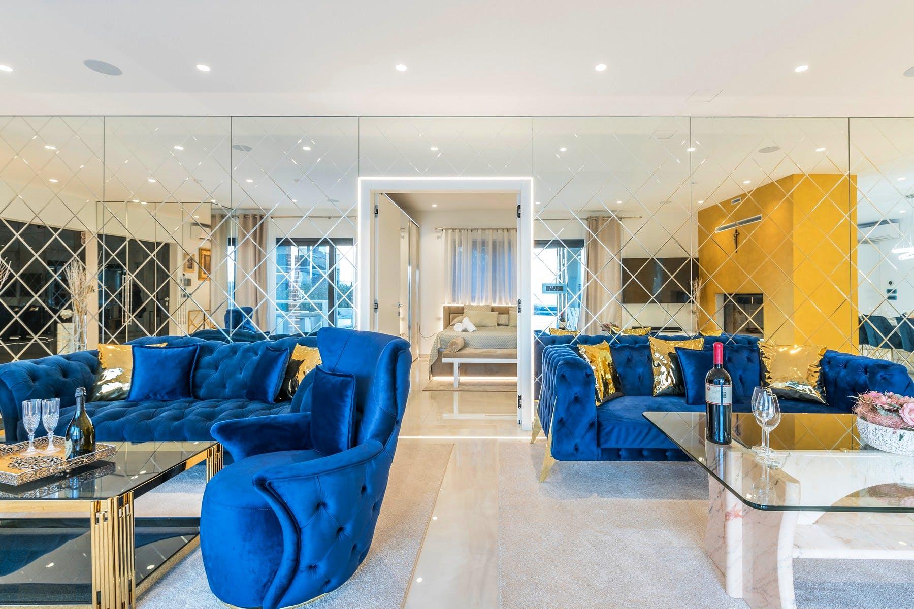 Glamorous interior enhanced by blue sofa