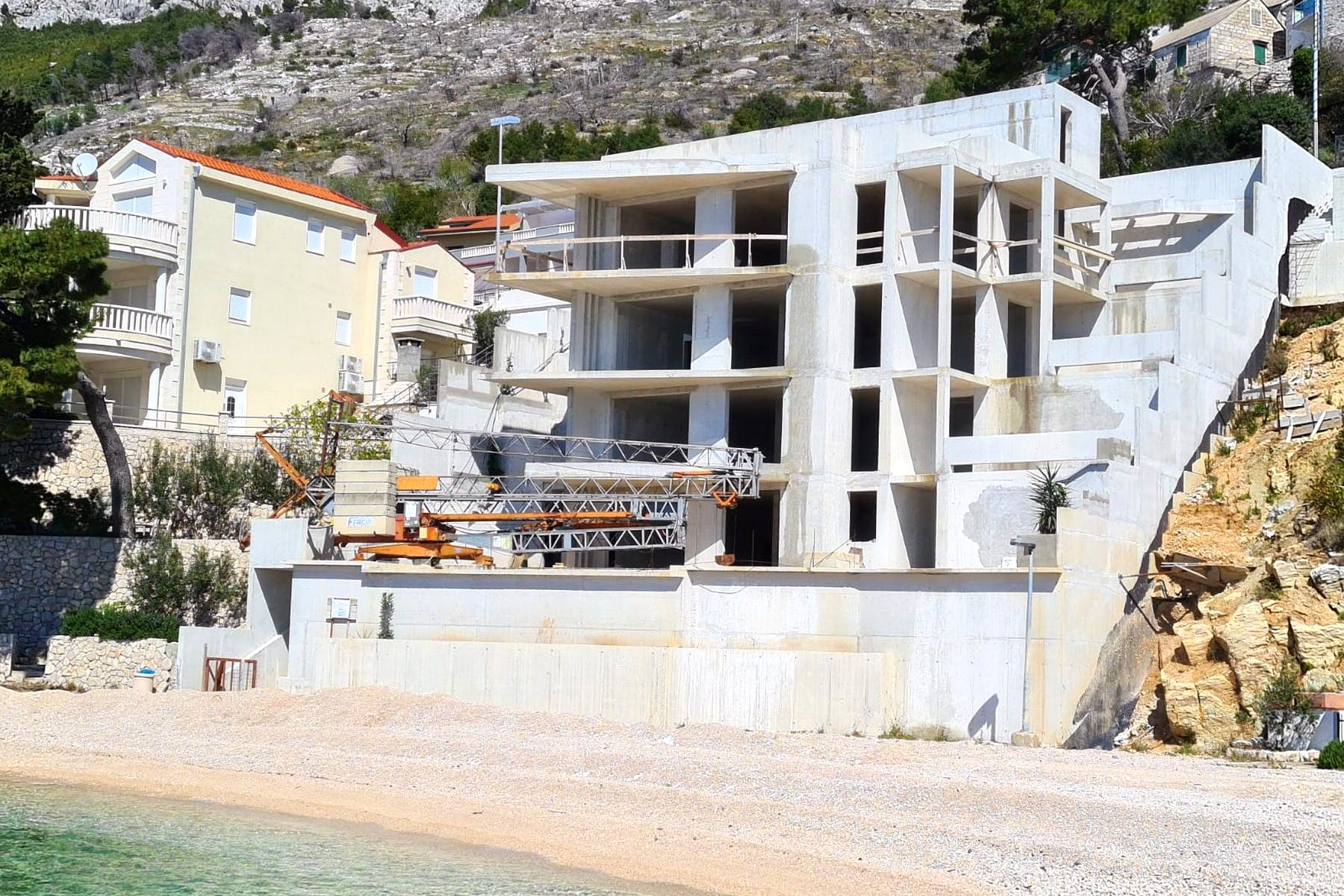 Modern villa under construction next to sea and beach for sale