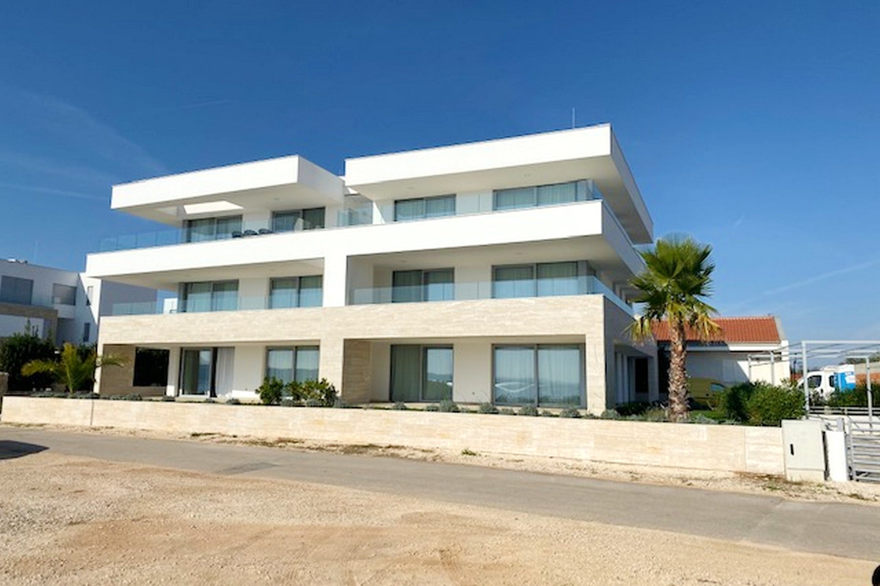Contemporary style building with apartments for sale