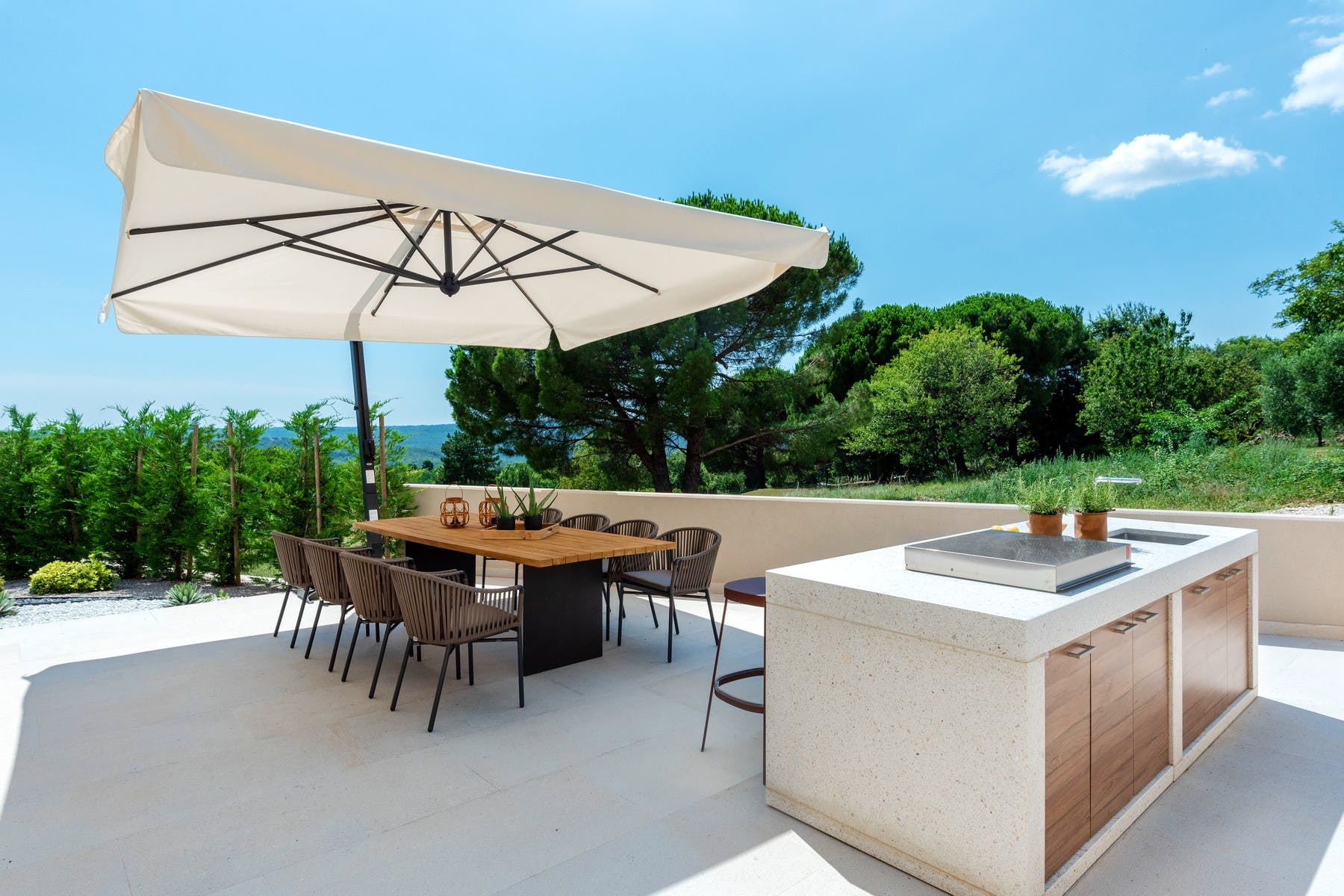 Spacious terrace with dining area and summer kitchen