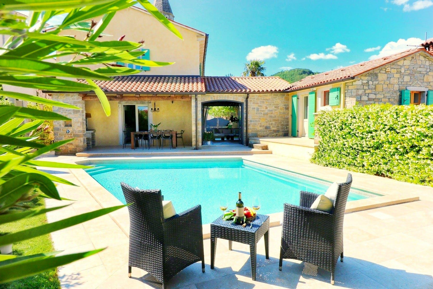 Heated swimming pool with sunbathing area