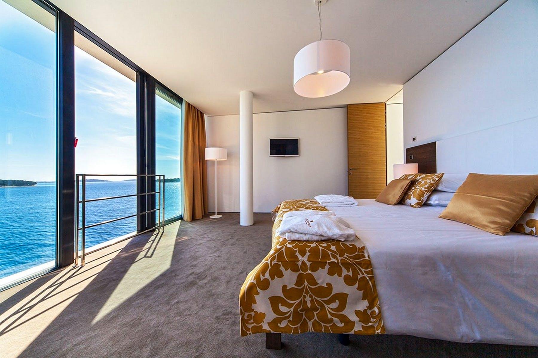 En-suite bedroom with open sea view