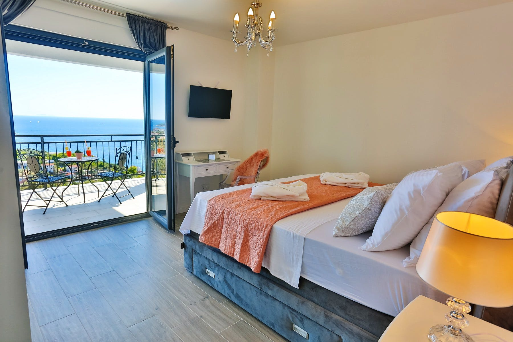 Modern bedroom with a sea view from the balcony