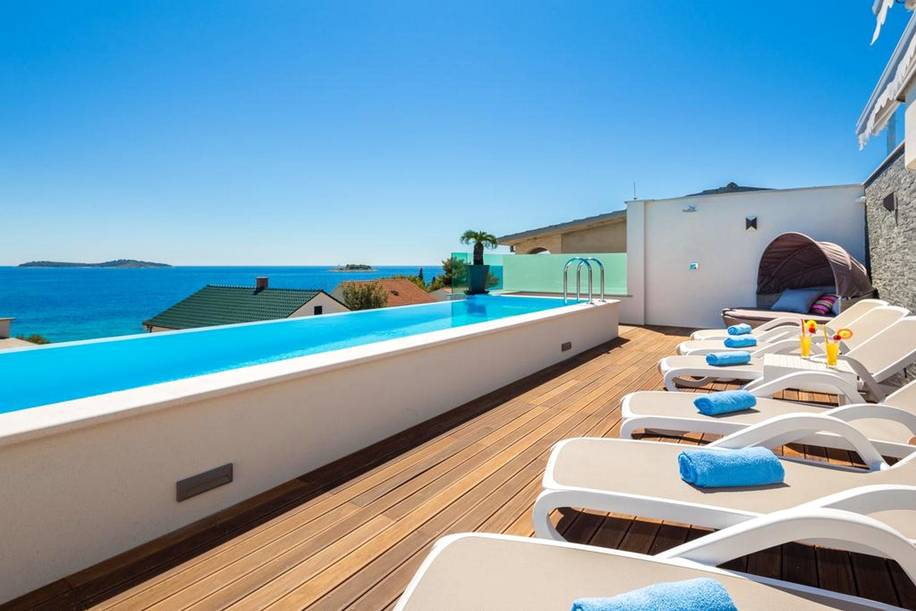 Spacious terrace with swimming pool, sun deck and stunning sea view
