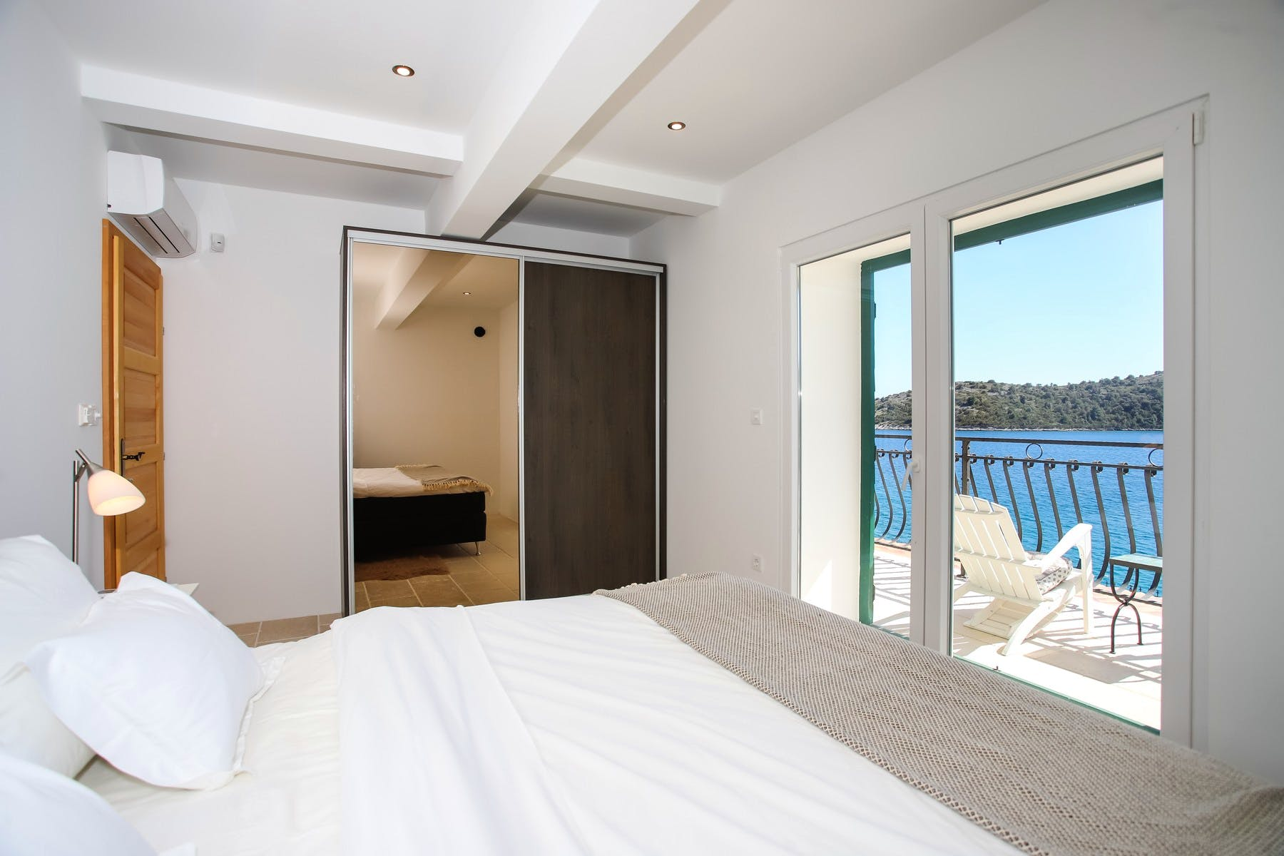 En suite bedroom with stunning sea view