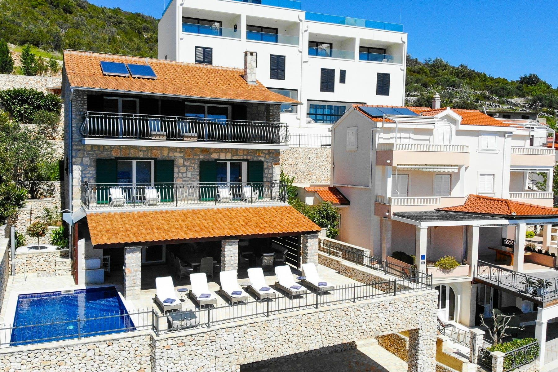Seafront stone villa for sale