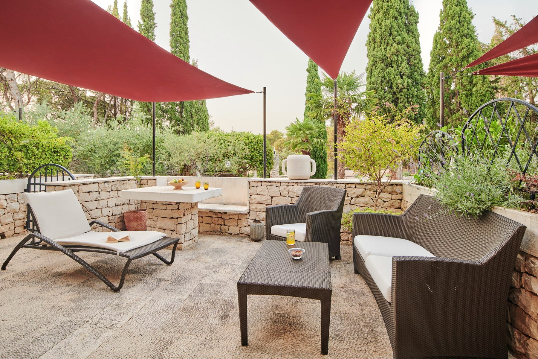 Spacious outdoor terrace surrounded by lush greenery