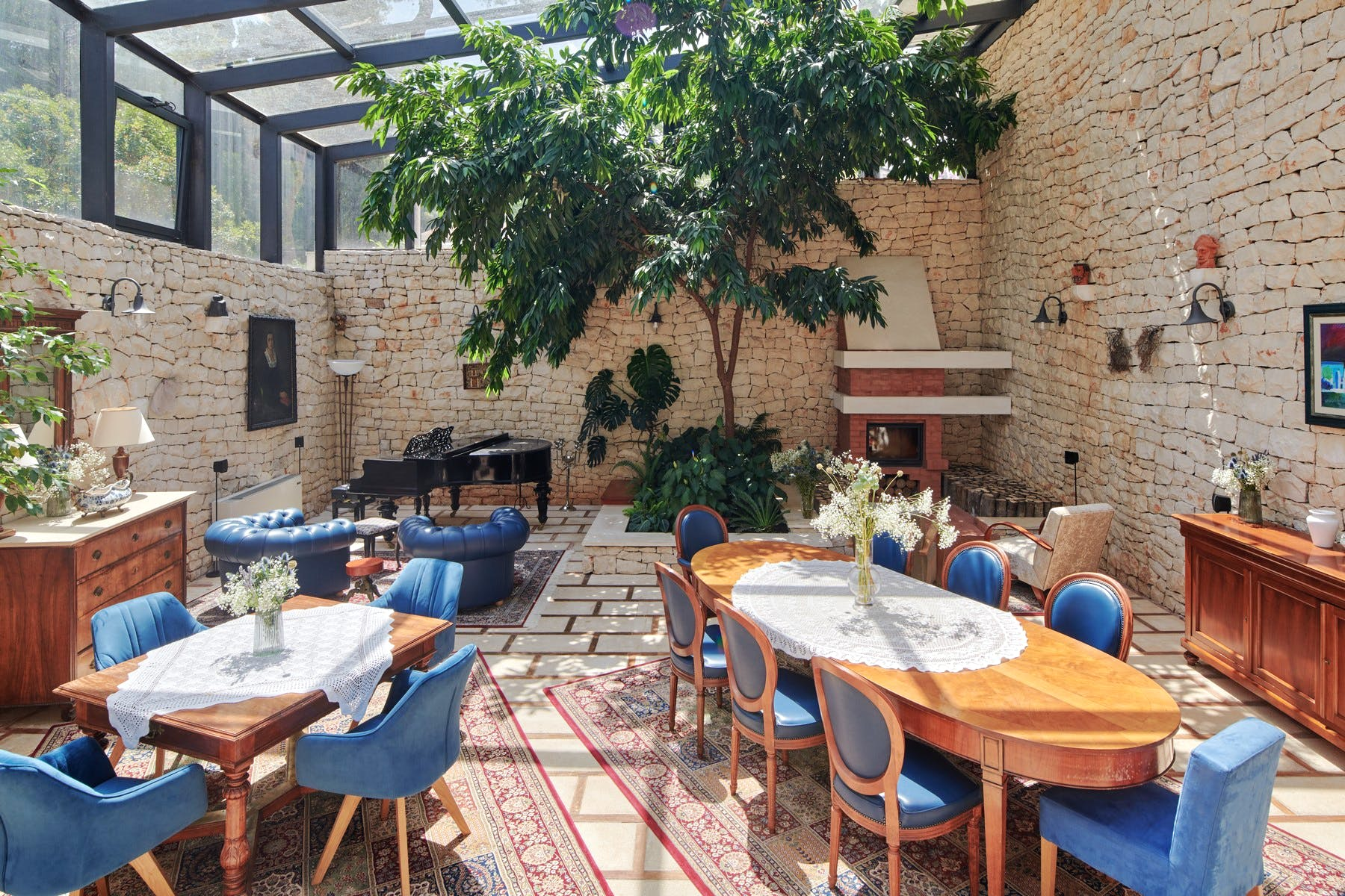 Spacious dining room enhanced by stone walls and greenery