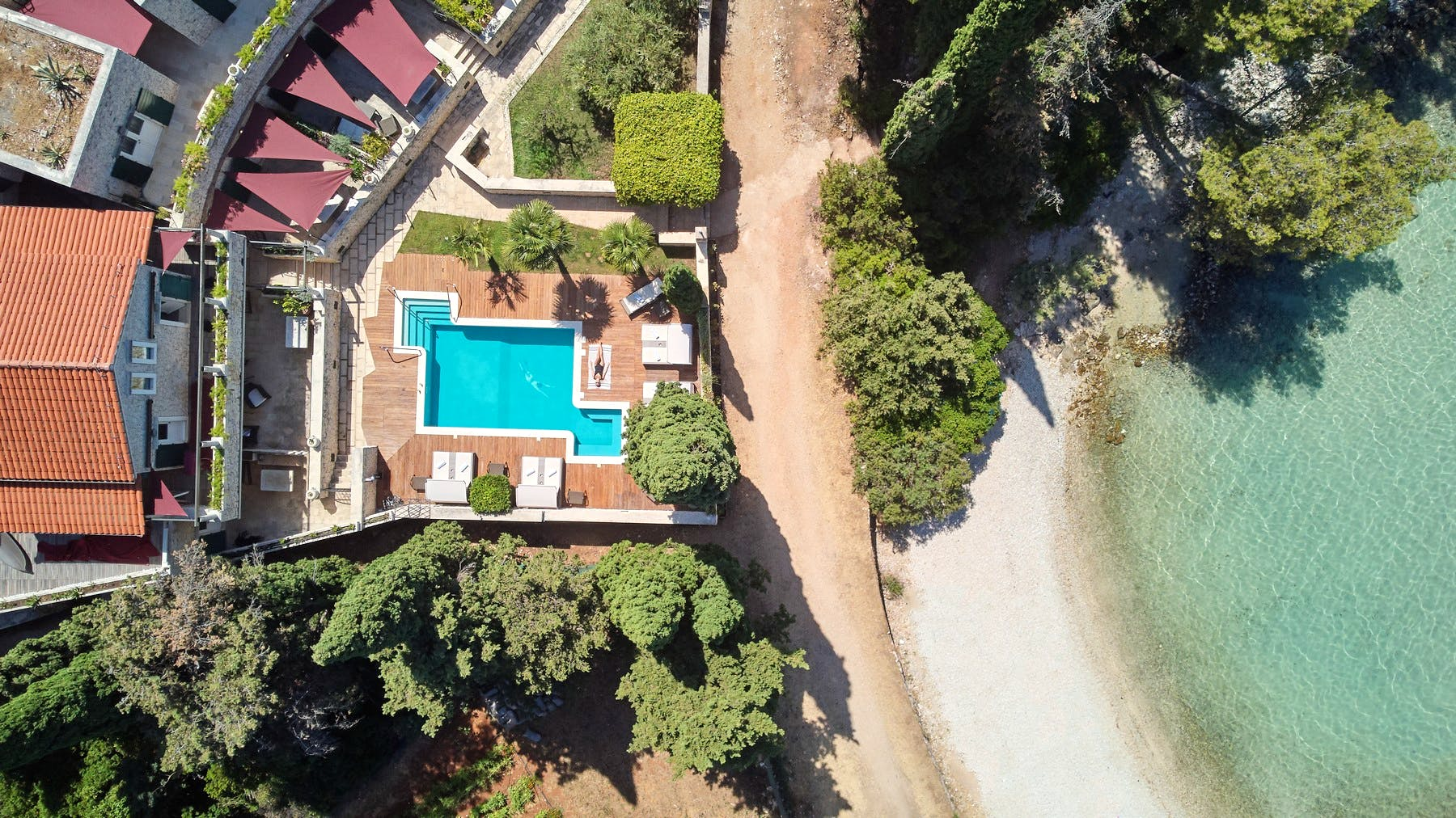 Large swimming pool terrace located right by the sea