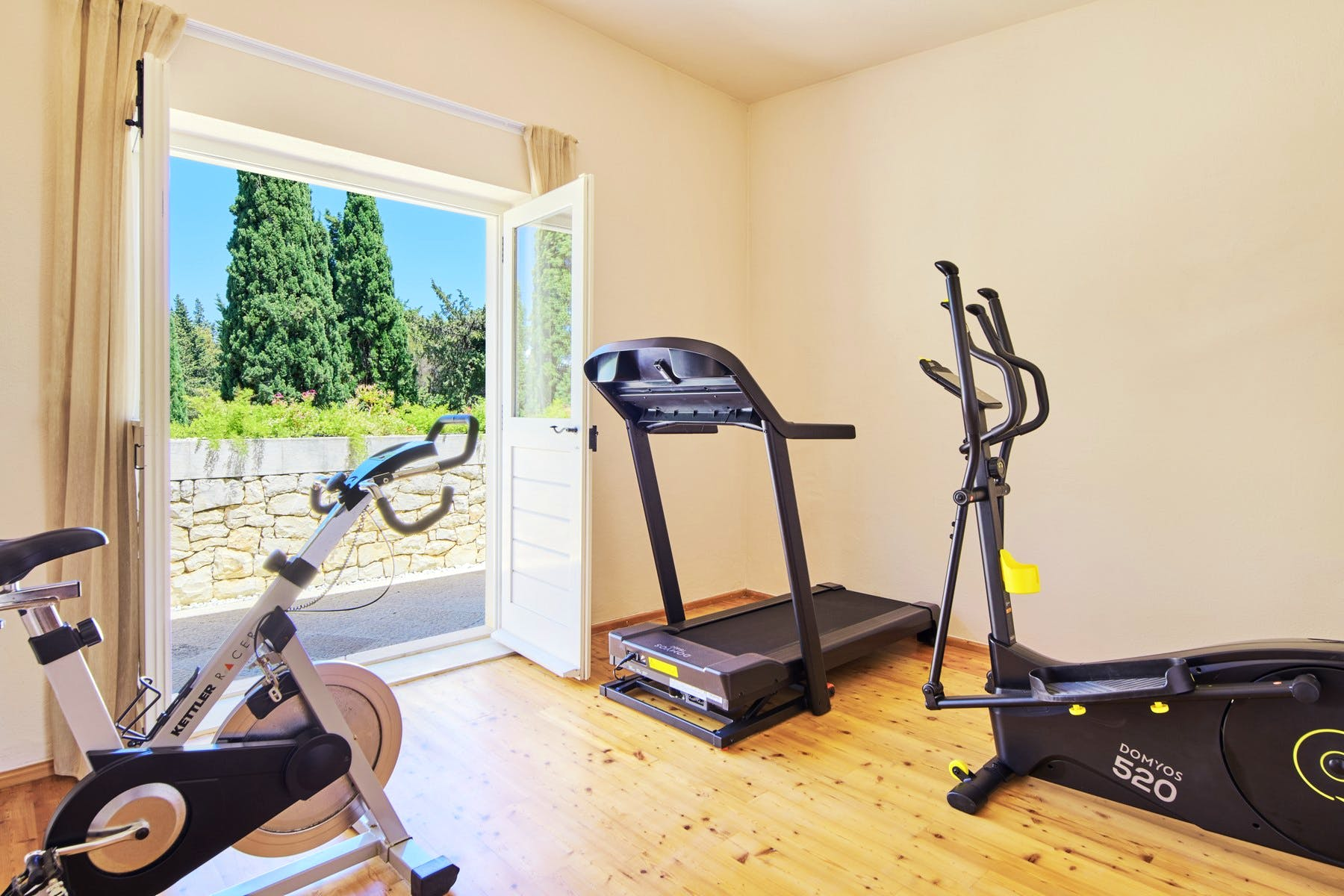 Indoor gym with direct exit to the outdoor terrace