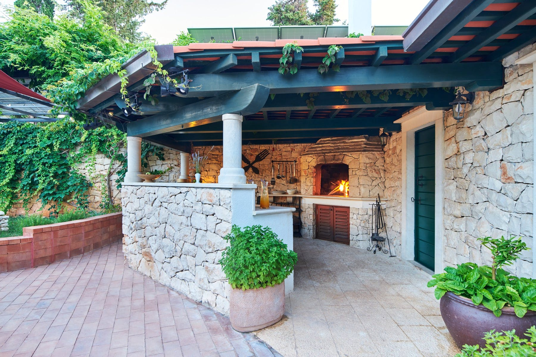 Outdoor fireplace with dining area