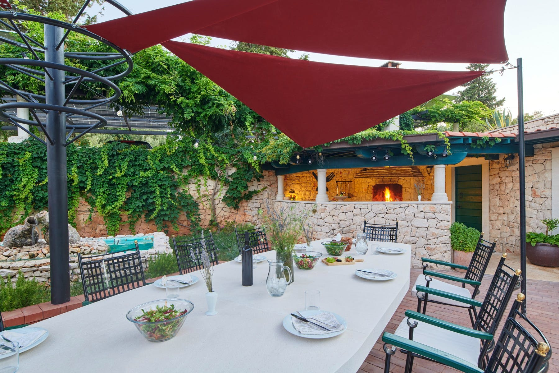 Spacious outdoor dining are with stone fireplace