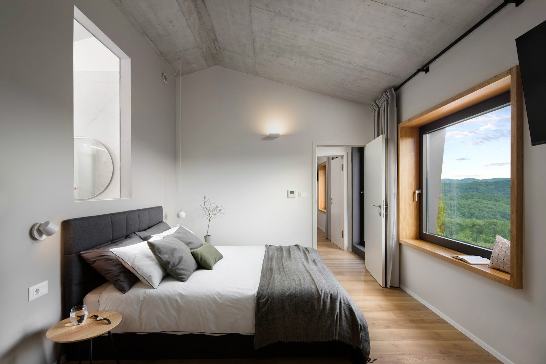 Modern ensuite bedroom with stunning view