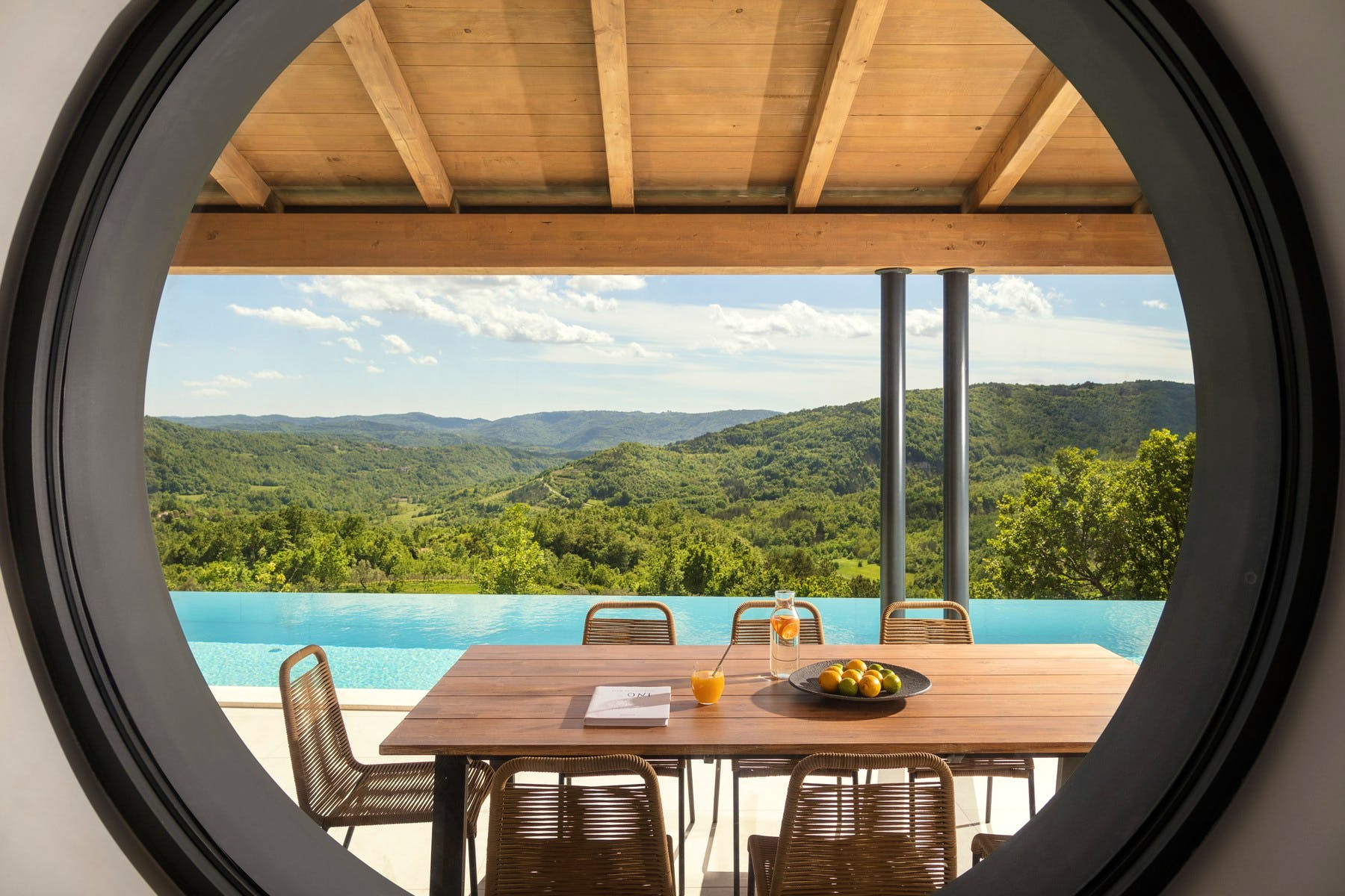 Covered terrace with dining area andstunning view