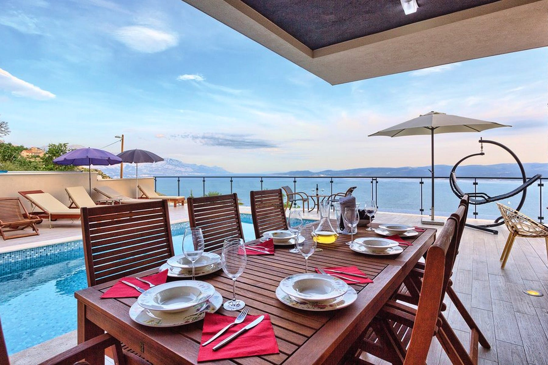 Dining area by the pool with stunning sea view