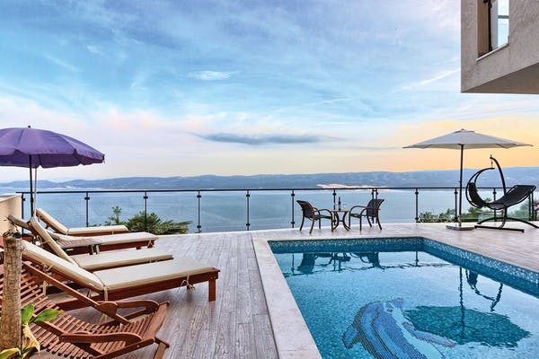 Spacious terrace with swimming pool, sundeck and stunning sea view