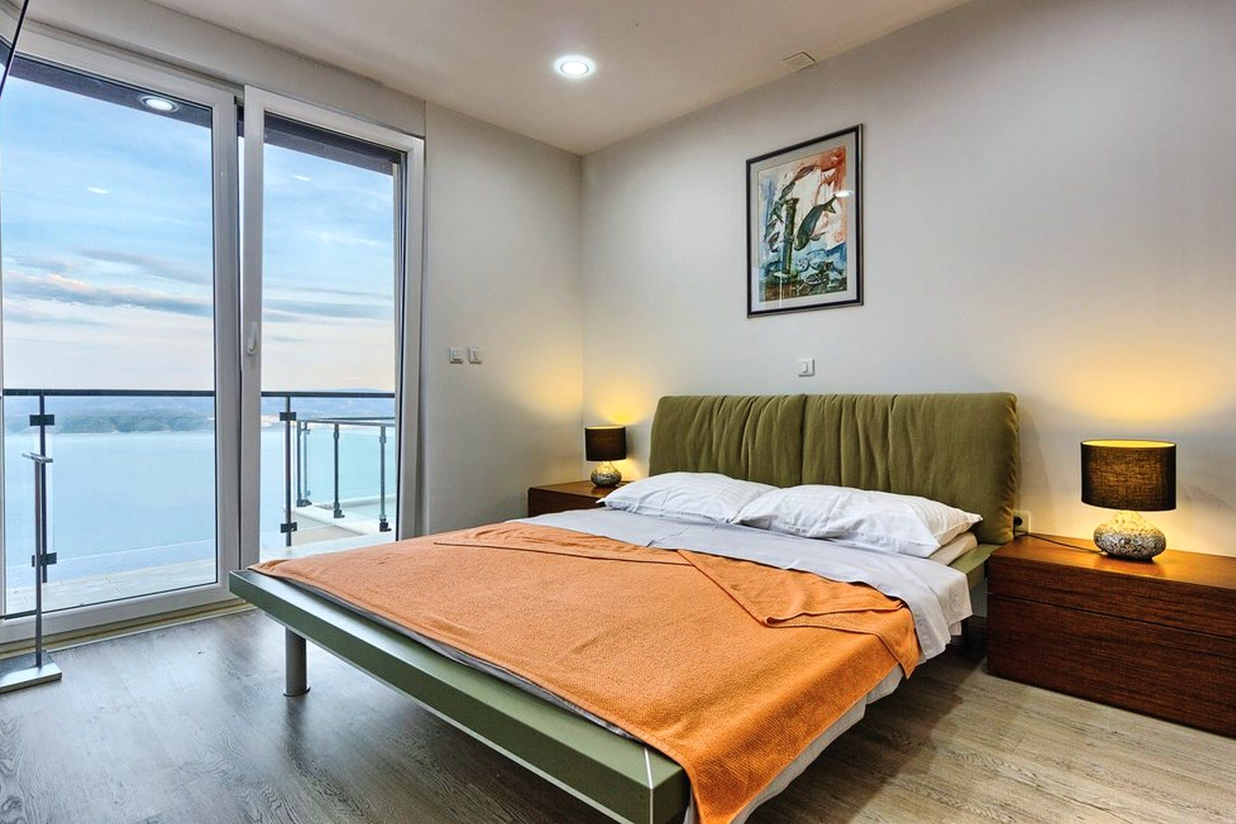 Contemporary ensuite bedroom with open sea view