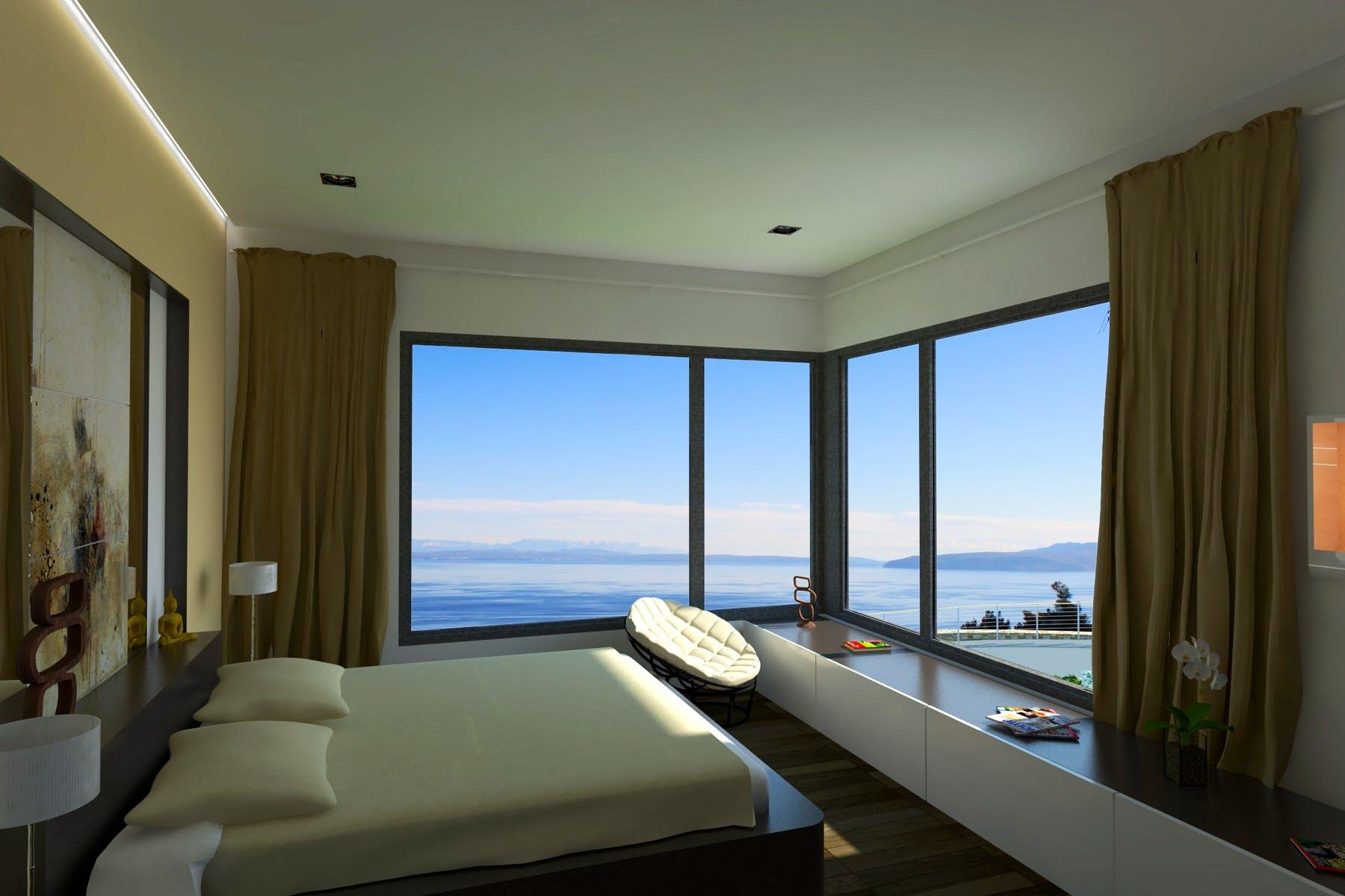 Udobna spavaća soba s pogledom na more